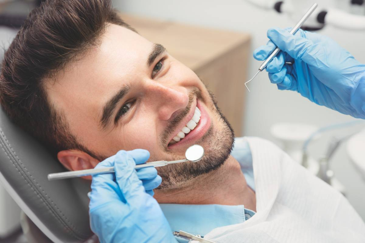 Man attending his important regular dental exams.